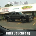 Ultra douchebag at empty local groceries took uo 3 space but 4 if u count the one behind him (cos if you park there you will be killed when he reverses lol)