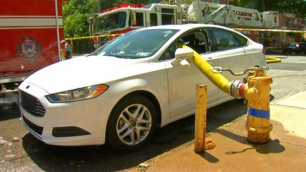 Parking in front of a fire hydrant? Ok, fine. We'll work with that. - meme